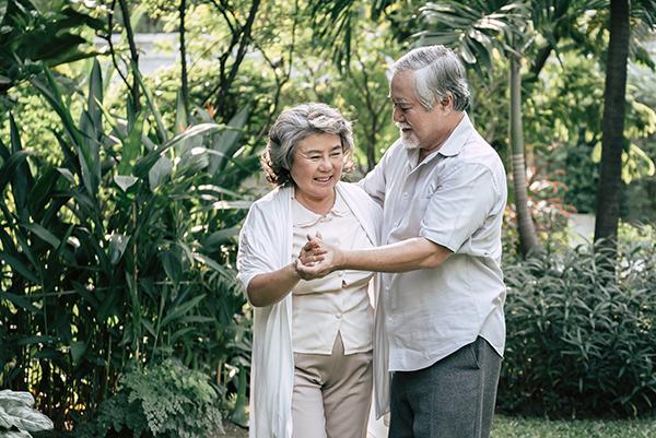 elderly couple dancing on holiday